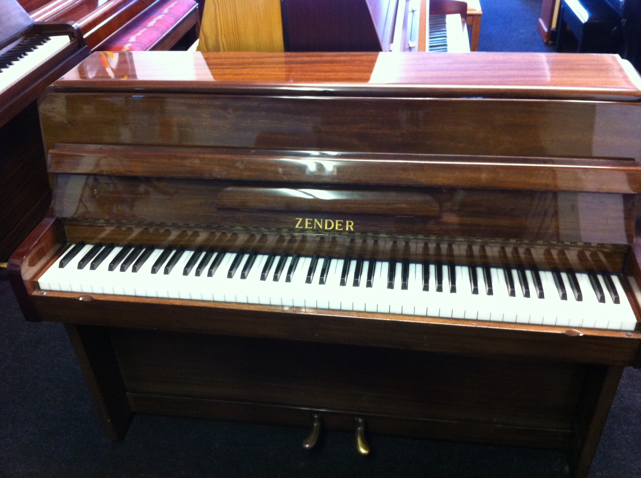 Zender Piano polished walnut